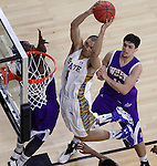 SIOUX FALLS, SD - MARCH 7: Skyler Flatten #1 of South Dakota State sails toward the basket past Western Illinois defenders Devante Mayes #11 and Jamie Batish #10 during their first round game at the men's Summit League Championship Tournament Saturday evening at the Denny Sanford Premier Center in Sioux Falls, SD.  (Photo by Ty Carlson/Inertia)