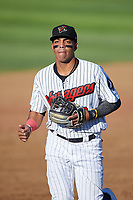 Great Falls Voyagers shortstop Lency Delgado (12) jogs off the field between innings of a Pioneer League game against the Missoula Osprey at Centene Stadium at Legion Park on August 19, 2019 in Great Falls, Montana. Missoula defeated Great Falls 4-1 in the first game of a doubleheader. Games were moved from Missoula after Ogren Park at Allegiance Field, the Osprey's home field, was ruled unplayable. (Zachary Lucy/Four Seam Images)