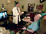 Doctor making housecall in patients home