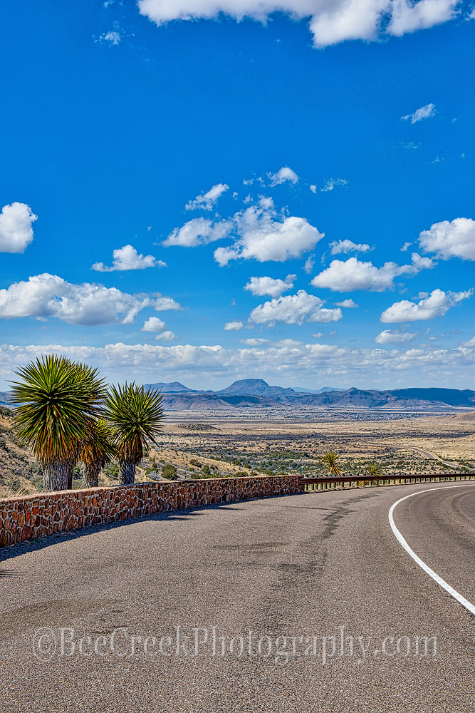This is a vertical version of the Scenic road to Alpine with this great blue sky and clouds.