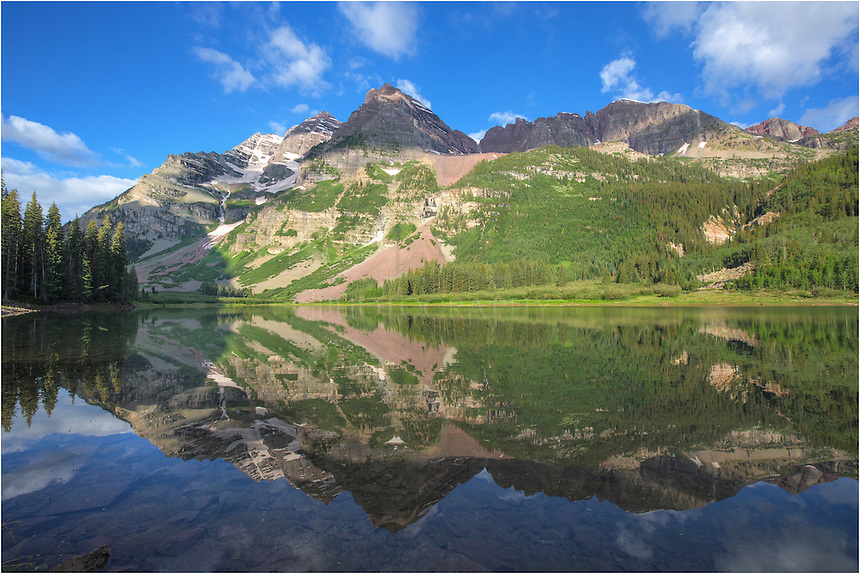 An early morning hike in the Maroon Bells Wilderness led me to the still waters of Crater Lake. High in the Rocky Mountains beneath the iconic 14ers, Maroon and North Maroon Peaks, the air is fresh and the waters clear. Colorado landscapes and images are easy to find in this area. Along the path, I never saw another person *(probably because I was there so early), but I did pass more than several folks on the way back to the car.
