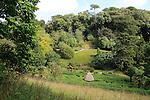 Maze in foreground at Glendurgan Garden, Cornwall, England, UK