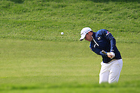 Richie Ramsay (SCO) chips onto the 5th green during Sunday's Final Round of the 2014 BMW Masters held at Lake Malaren, Shanghai, China. 2nd November 2014.<br /> Picture: Eoin Clarke www.golffile.ie