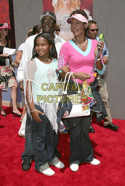 "BOBBY BROWN, WHITNEY HOUSTON & BOBBI KRISTINA.Attends the World Premiere of Walt Disney Pictures' ""The Princess Diaries 2: Royal Engagement"" held at AMC Downtown Disney in Anaheim, California,.August 7th 2004.full length family husband wife daughter child pink visor top casual large white bag.Ref: DVS.www.capitalpictures.com.sales@capitalpictures.com.©Capital Pictures."