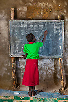 Student in School, Juba, South Sudan 2012<br /> Poverty remains the most important factor for determining whether a girl can access an education. Ask any woman in any of these countries why she's laboring with such intensity, and she will tell you that it's to send her children to school, especially her girls. Every one of these women hopes that her daughter will be educated and have a better life than she does. According to UNESCO estimates, 130 million girls between the age of 6 and 17 are out of school, and 15 million girls of primary-school age—half of them in sub-Saharan Africa—will never enter a classroom. Better educated women tend to be healthier, participate more in the formal labor market, earn higher incomes, have fewer children, marry at a later age, and provide better health care and education for their children. All these factors combined can help lift households, communities, and nations out of poverty.
