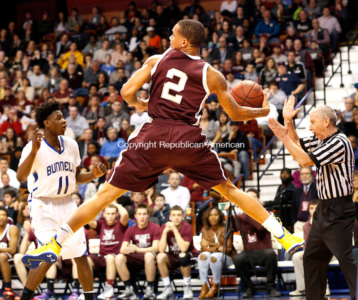 Uncasville, CT- 22 March 2015-032215CM39- Naugatuck's Jarron Chapman attempts to save the ball during the Class L state championship game against Bunnell at Mohegan Sun Arena in Uncasville on Sunday. The Greyhounds lost to Bunnell, 72-61.    Christopher Massa Republican-American