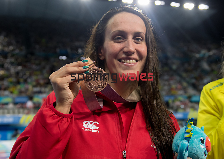 Wales Georgia Davies with her bronze medal from the Woman's 50m Backstroke<br /> <br /> *This image must be credited to Ian Cook Sportingwales and can only be used in conjunction with this event only*<br /> <br /> 21st Commonwealth Games - Swimming -  Day 6 - 10\04\2018 - Gold Coast Optus Aquatic centre - Gold Coast City - Australia