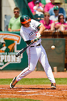 Brad Fieger #27 of the Miami Hurricanes connects for an RBI single in the bottom of the 1st inning against the Georgia Tech Yellow Jackets at the 2012 ACC Baseball Championship at NewBridge Bank Park on May 27, 2012 in Winston-Salem, North Carolina.  The Yellow Jackets defeated the Hurricanes 8-5.  (Brian Westerholt/Four Seam Images)