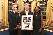 United States President Bill Clinton meets with US Open Tennis Champions Andre Agassi and Serena Williams in the Oval Office of the White House in Washington, DC on December 15, 1999. From Left to Right: Andre Agassi, President Clinton, Serena Williams.<br /> Mandatory Credit: Ralph Alswang / White House via CNP