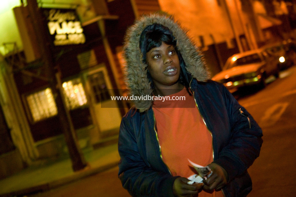 A woman, standing on a street corner in a North Philadelphia neighborhood, USA, talks about issues of gun violence to a reporter (not pictured) 28 March 2007. Philadelphia, a city of about 1.4 million people known as the City of Brotherly Love, has one of the highest murder rates in the country. While the nation's other big cities - New York, Los Angeles, Chicago and Houston - are all seeing their murder numbers fall. Photo Credit: David Brabyn.