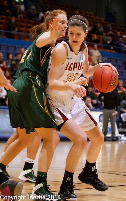 SIOUX FALLS, SD - MARCH 8:  Nevena Markovic #34 of IUPUI drives into North Dakota State defender Liz Keena #21 during their quarterfinal game at the 2014 Summit League Basketball Championships at the Sioux Falls Arena.  (Photo by Dick Carlson/Inertia)