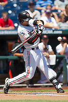 Oregon State shortstop Tyler Smith (1) swings the bat against the Louisville Cardinals during Game 5 of the 2013 Men's College World Series on June 17, 2013 at TD Ameritrade Park in Omaha, Nebraska. The Beavers defeated Cardinals 11-4, eliminating Louisville from the tournament. (Andrew Woolley/Four Seam Images)
