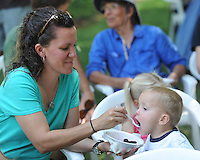 NWA Democrat-Gazette/ANDY SHUPE<br /> Amy Calhoun of Goshen feeds ice cream Saturday, Aug. 15, 2015, to her 2-year-old son, Josiah, during the 44th annual Washington County Historical Society Ice Cream Social at Headquarters House in Fayetteville. The annual event featured music, ice cream, desserts and tours of the Civil War-era house and museum.