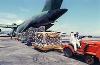 Kigali, Rwanda airport workers unload a U.S. Air Firce C-5 cargo jet which delivered medical and other supplies for Connecticut-based humanitarian organization AmeriCares and othe non-governmental organizations in Oct 1994. Organizations converged on Rwanda to help relieve the suffering in the aftermath of genocide and civil war which rocked that nation in 1994. (photo Rick D'Elia)