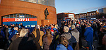 Rangers fans gather around the John Greig statue in silence