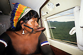 Amazon, Brazil. Chief Raoni of the Megranoti (Kayapo Nation) with botoque and feather cocar headdress in an airplane.