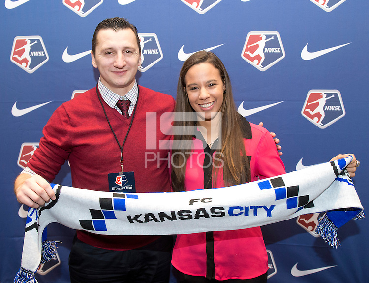 #19 overall pick Frances Silva of FC Kansas City stands with head coach Vlatko Andonovski during the NWSL draft at the Pennsylvania Convention Center in Philadelphia, PA, on January 17, 2014.