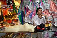 AFGHANISTAN, 06.2008, Kabul. Markt/Basar: Es mag aussehen wie Folklore-Artikel fuer Touristen, aber in Afghanistan gibt es keine Touristen. Traditionelle Kleidung zu tragen ist immer noch ganz natuerlich.   Market/Bazaar:  It may look like folklore items for tourists, but there are no tourists in Afghanistan. Wearing traditional dresses is still very natural.<br /> © Marzena Hmielewicz/EST&OST