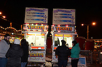 The carnival rides and games become magical at night at the 2013 Anchorage, Alaska, Fur Rendezvous.