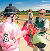 Sean Jones helping Kali Francois with her tack after winning aboard Cadillac Rose at Delaware Park on 9/23/15