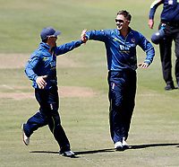 Joe Denly (R) is congratulated by Heino Kuhn after he took the wicket of Rilee Rossouw during the Royal London One Day Cup Final between Kent and Hampshire at Lords Cricket Ground, London, on June 30, 2018
