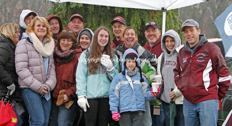 Darien, CT-120614MK09  Naugatuck Greyhound Fans gather under a tent to stay out of the rain during half-time at the CIAC Class L Large semi-final game at Darien High School Saturday afternoon. Darien defeated Naugatuck 42-12. Michael Kabelka / Republican-American