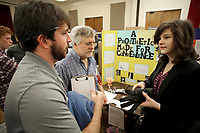 NWA Democrat-Gazette/DAVID GOTTSCHALK Jasmine Dufresne (from right), an eighth grade student at Alma Middle School, describes her project Friday, March 2, 2018, to Tom Costello and Colby Reavis, judges at the 2018 Northwest Arkansas Regional Science and Engineering Fair at the Arkansas Union on the campus of the University of Arkansas in Fayetteville. The fair had displays in middle school, junior high and senior high school divisions.
