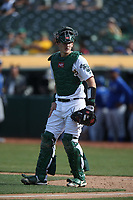 OAKLAND, CA - SEPTEMBER 18:  Sean Murphy #12 of the Oakland Athletics works behind the plate against the Kansas City Royals during the game at the Oakland Coliseum on Wednesday, September 18, 2019 in Oakland, California. (Photo by Brad Mangin)