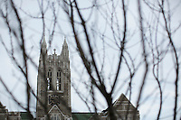 The tower of Gasson Hall stands above Boston College's Chestnut Hill, Massachusetts, campus on Tues., Dec. 17, 2013.
