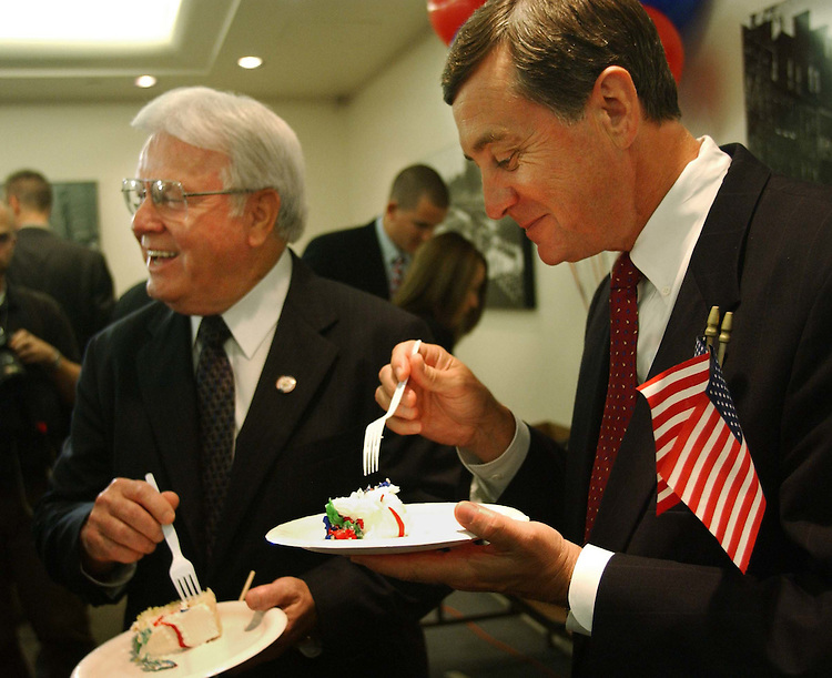 9/22/04.HOUSE GOP ACCOMPLISHMENTS--Henry E. Brown Jr., R-S.C., and Gil Gutknecht, R-Minn., enjoy cake after a rally of House Republicans celebrating ten years of their majority rule.  CONGRESSIONAL QUARTERLY PHOTO BY SCOTT J. FERRELL