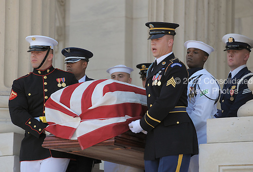 An honor guard carries the casket of United States Senator Robert Byrd (Democrat of West Virginia) down the Senate Steps of the U.S. Capitol, Thursday, July 1, 2010 in Washington, DC.  Byrd, history's longest-serving member of Congress, died Monday, aged 92. .Credit: Mandel Ngan - Pool via CNP