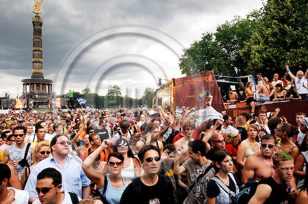 """BERLIN - GERMANY 15. JULY 2006 -- Ravers dance during the 'Love Parade' on the 'Straße des 17. Juni' in front of the 'Siegessaeule' in Berlin, Saturday, 15 July 2006. Under the motto 'The Love is Back' hundreds of thousand ravers celebrated in Berlin's city centre.  -- PHOTO: GORM K. GAARE / EUP- IMAGES..This image is delivered according to terms set out in """"Terms - Prices & Terms"""". (Please see www.eup-images.com for more details)"""