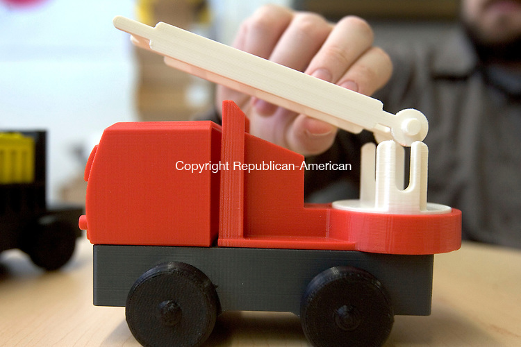 DANBURY CT. 19 May 2014-051914SV07-James Barber and his son Luke Barber both of Newtown started a kickstarter campaign, to manufacture toys.&nbsp;This is a prototype of the project in their office in Danbury Monday.<br /> Steven Valenti Republican-American