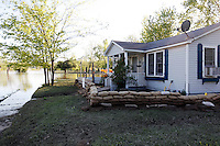 Mississippi River floodwater recedes from the home of Bill and Laura Sandquist in the Red Star District of Cape Girardeau, MO, on Wednesday, May 4, 2011. Since the Birds Point levee was intentionally breached by the Army Corps of Engineers on Monday, May 2, 2011, the Mississippi River floodwater have receded at least two feet, according to resident Peggy Benaivdz.