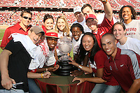 14 October 2006: Matt Gentry, Tanner Gardner, Katie Goldhahn, Lizzie Suiter, Njideka Nnamani, John Dunning, Kris Mack, Jenna Seki, Teddy Collins and others surround the Director's Cup during Stanford's 20-7 loss to Arizona during Homecoming at Stanford Stadium in Stanford, CA.