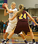 SIOUX FALLS, SD - JANUARY 30:  Teagan Molden #30 from the University of Sioux Falls looks for a teammate as Anna Monke #24 from Minnesota Duluth defends Friday night at the Stewart Center. (Photo by Dave Eggen/Inertia)