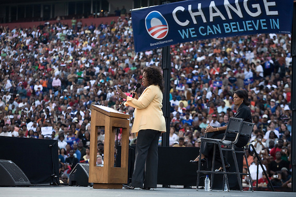December 9, 2007. Columbia, SC.. Democratic presidential hopeful and US Senator, Barack Obama held a rally at the University of South Carolina's football stadium, drawing a crowd of an estimated 29,000 people, with special guest Oprah Winfrey.. Oprah took the stage to great applause. Michelle Obama looks on.. .. .