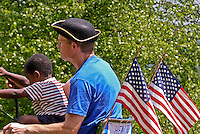 Northeastern Vermont celebration of Independance day with a large tractor parade brings out everyone and their helpers to be greeted by the enthusiastic crowds