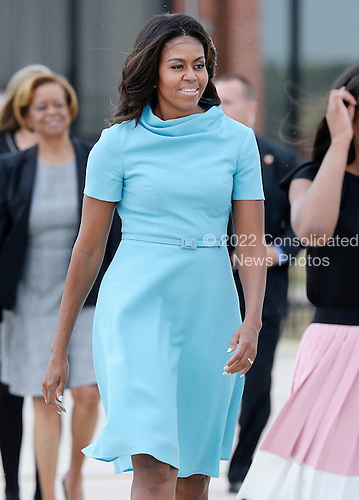 First Lady Michelle Obama arrives to welcome His Holiness Pope Francis on his arrival at Joint Base Andrews in Maryland on September 22, 2015. The Pope is making his first trip to the United States on a three-city, five-day tour that will include Washington, D.C., New York City and Philadelphia. <br /> Credit: Olivier Douliery / Pool via CNP