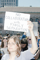 """A woman holds a sign reading """"No collaboration with family separation"""" as Wayfair employees demonstrate in Copley Square to protest their company's sale of furniture to detainment camps for children operated by US Customs & Border Protection (CBP) on the Mexico border in Boston, Massachusetts, USA, on Wed., June 26, 2019. Wayfair is an online furniture retailer. Employees are asking for the company to set ethics standards for sales. The Wayfair employees were joined by union representatives, PRIDE activists, and other groups in solidarity.  This action occurred the week after US government legal representatives argued that children held in CBP facilities did not need soap or beds to meet the """"safe and sanitary"""" standard of care required by law after months and years of criticism of Trump administration policies of family separation and cruel treatment of those held at its facilities."""