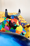 August 9, 2012. Durham, NC..  Artists from all over the state have been working at Golden Belt decorating their assigned cows for the Parade of Cows, to be held this month. After the cows are displayed around the Triangle, they will be auctioned off to benefit the NC Children's Hospital.