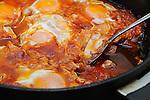 Fresh breakfast - eggs<br /> Fresh delicious breakfast served in hot pan- eggs shakshuka style