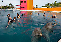 Tourists swim with the dolphins at Delfiniti Ixtapa in downtown Ixtapa. (photo taken August 2007) Photo by Patrick Schneider Photo.com