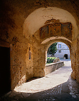 Tuscany, Italy:  Morning sun floods an arched passage in the fortress walls of Fortezza Orsini in the village of Sorano in southern Tuscany