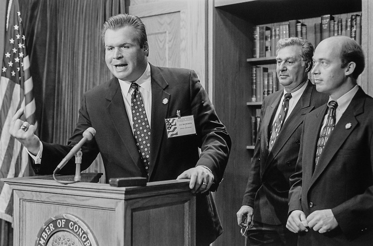 Rep.-elect J. D. Hayworth, R-Ariz., Rep.-elect Jerry Weller, R-Ill., appear with House Republican Conference Chairman Rep. Dick Armey, R-Tex., to announce their committee assignment on Dec. 9, 1994. (Photo by Chris Martin/CQ Roll Call via Getty Images)