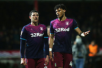 Aston Villa's Tyrone Mings (right) chats with Tommy Elphick as they walk towards the dressing room at half-time during Brentford vs Aston Villa, Sky Bet EFL Championship Football at Griffin Park on 13th February 2019