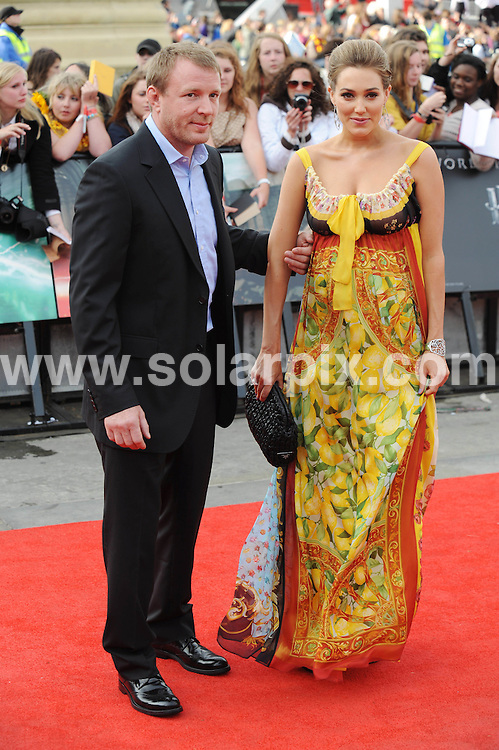 **ALL ROUND PICTURES FROM SOLARPIX.COM**                                             **WORLDWIDE SYNDICATION RIGHTS**                                                                                  Caption:  arrivals at the World Premiere of Harry Potter and The Deathly Hallows - Part 2, Trafalgar Square, London, UK. 7 July 2011                                                                             This pic: Guy Richie and Jacqui Ainsley                                                                                         JOB REF: 13679 LNJ       DATE: 07_07_2011                                                           **MUST CREDIT SOLARPIX.COM OR DOUBLE FEE WILL BE CHARGED**                                                                      **MUST AGREE FEE BEFORE ONLINE USAGE**                               **CALL US ON: +34 952 811 768 or LOW RATE FROM UK 0844 617 7637**
