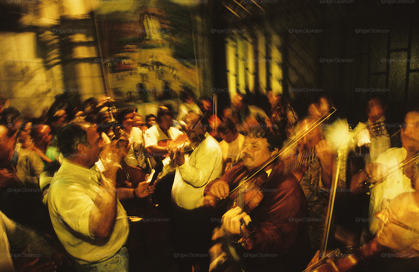 Roma, some from Django Reinhardt's family, play music during the Catholic Gypsy pilgrimage to Lourdes. France August 1997