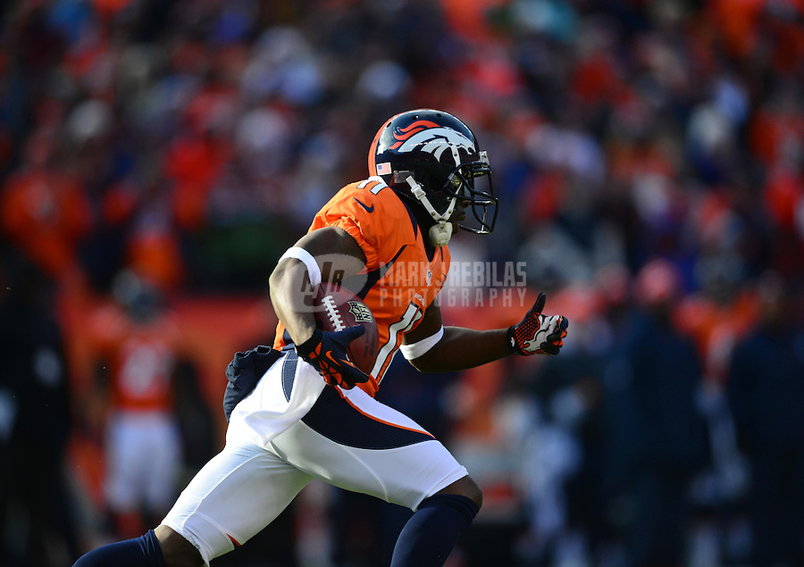 Jan 12, 2013; Denver, CO, USA; Denver Broncos wide receiver Trindon Holliday (11) runs for a touchdown against the Baltimore Ravens during the AFC divisional round playoff game at Sports Authority Field.  Mandatory Credit: Mark J. Rebilas-