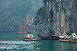 Vietnam's Ha Long Bay is one of the most dramatic landscapes in all of southeast Asia. Karst mountains and rocky pinnacles rise dramatically out of the bay. The unusual shape of the sails of the fishing craft complete the monochromatic scene. Ha Long Bay, Vietnam